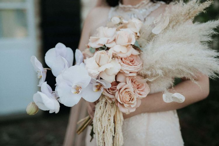 Stunning orchid bouquet with pampas grass