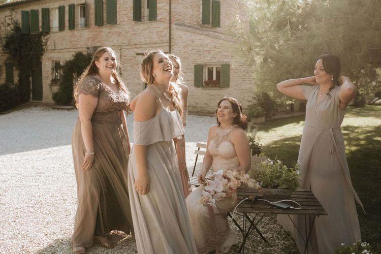 Mismatched neutral tone bridesmaid dresses