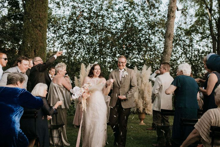 Confetti exit at outdoor ceremony for bride and groom