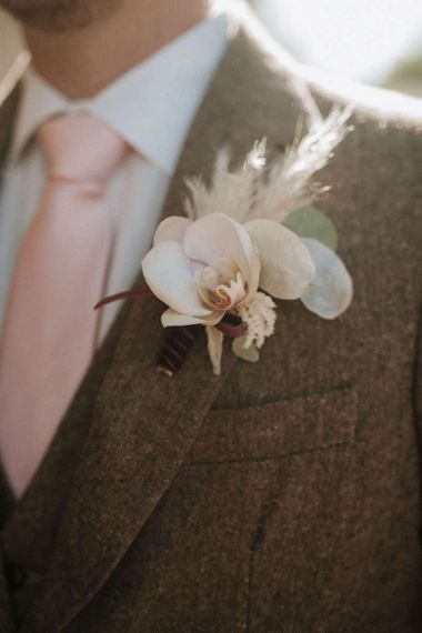 Wedding buttonhole to match orchid bouquet