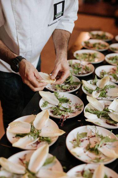 Chefs prepare wedding breakfast at Italian wedding