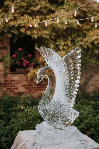 Swan ice sculpture at Italian wedding