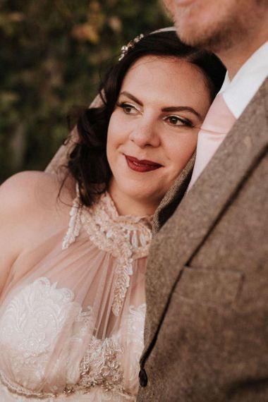 Bride in homemade halterneck wedding dress