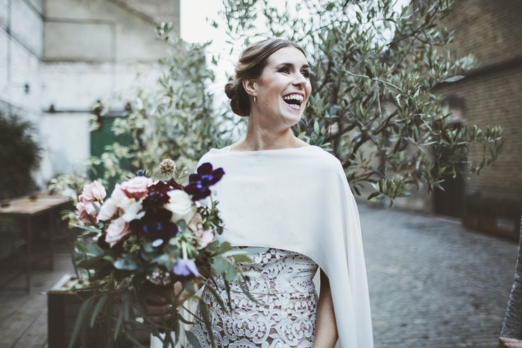 Bride in  Avalon Dress by Francis Bridal with Cape from Cupid Blue Bridal