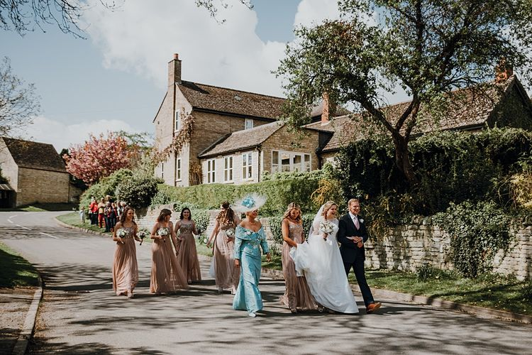 Bridal Party Entrance | Bride in Bespoke Gown | Bridesmaids in Pink ASOS Dresses | Homemade, Homegrown Village Marquee Wedding with Greenery | Rustic DIY Decor | Claire Fleck Photography | Second Shooter Oscar Davies Photography