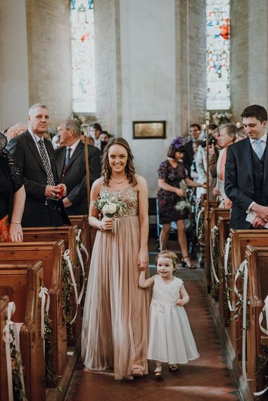 Wedding Ceremony | Bridesmaid Entrance in ASOS Dress | Homemade, Homegrown Village Marquee Wedding with Greenery | Rustic DIY Decor | Claire Fleck Photography | Second Shooter Oscar Davies Photography