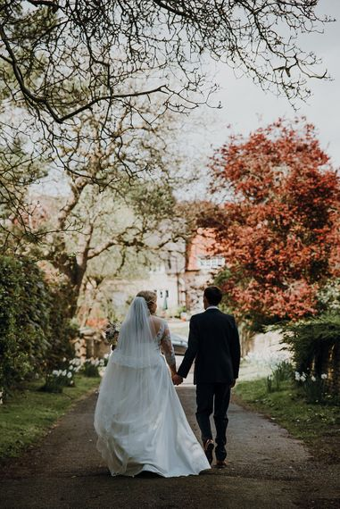 Bride in Bespoke Gown | Groom in Navy Suit | Homemade, Homegrown Village Marquee Wedding with Greenery | Rustic DIY Decor | Claire Fleck Photography | Second Shooter Oscar Davies Photography