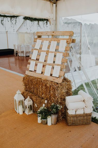 Wooden Palette Table Plan | Homemade, Homegrown Village Marquee Wedding with Greenery | Rustic DIY Decor | Claire Fleck Photography | Second Shooter Oscar Davies Photography