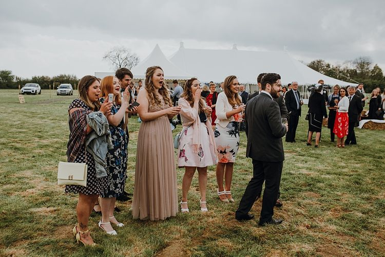Wedding Guests | Homemade, Homegrown Village Marquee Wedding with Greenery | Rustic DIY Decor | Claire Fleck Photography | Second Shooter Oscar Davies Photography