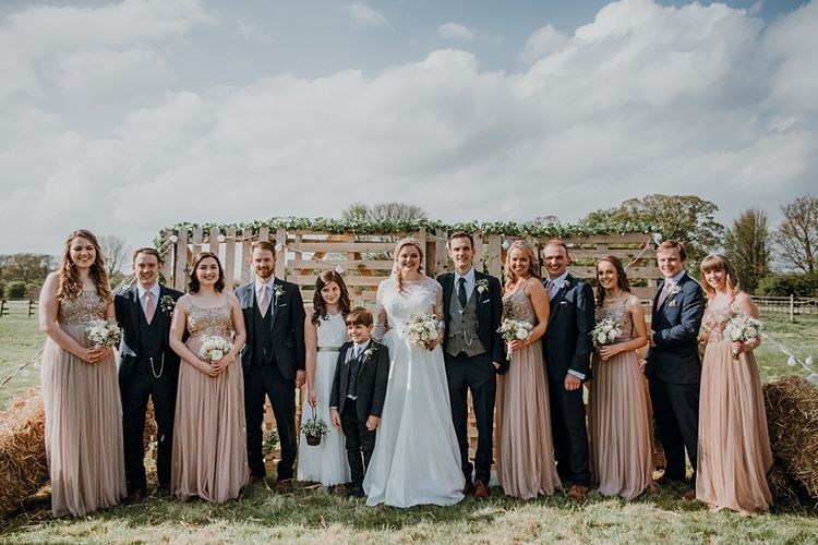 Wedding Party | Pink ASOS Bridesmaid Dresses | Bespoke Bridal Gown | Groomsmen in Navy Suits | Homemade, Homegrown Village Marquee Wedding with Greenery | Rustic DIY Decor | Claire Fleck Photography | Second Shooter Oscar Davies Photography