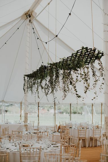 Greenery Hanging Installation | Homemade, Homegrown Village Marquee Wedding with Greenery | Rustic DIY Decor | Claire Fleck Photography | Second Shooter Oscar Davies Photography