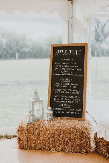 Chalkboard Menu Sign | Homemade, Homegrown Village Marquee Wedding with Greenery | Rustic DIY Decor | Claire Fleck Photography | Second Shooter Oscar Davies Photography