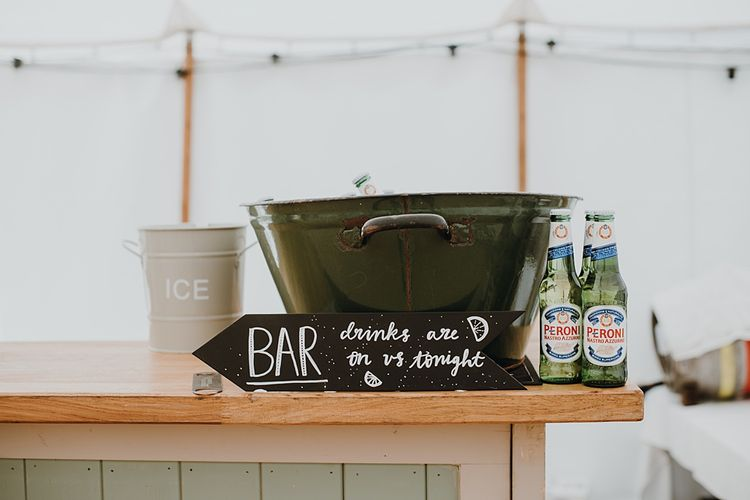 Bar | Homemade, Homegrown Village Marquee Wedding with Greenery | Rustic DIY Decor | Claire Fleck Photography | Second Shooter Oscar Davies Photography