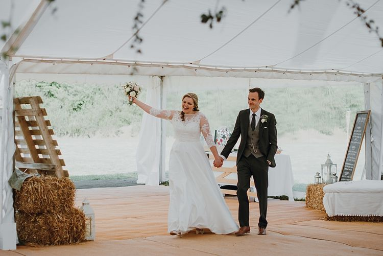 Bride and Groom Reception Entrance | Homemade, Homegrown Village Marquee Wedding with Greenery | Rustic DIY Decor | Claire Fleck Photography | Second Shooter Oscar Davies Photography