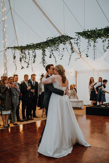 First Dance | Bride in Bespoke Gown | Groom in Navy Suit | Homemade, Homegrown Village Marquee Wedding with Greenery | Rustic DIY Decor | Claire Fleck Photography | Second Shooter Oscar Davies Photography