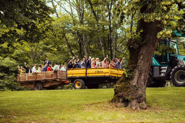 Wedding Guests On Tractor // La Leotardie French Destination Wedding Venue With Accommodation // Halfpenny London Bride // Bridesmaids In Green Dresses // Michelle Wood Photographer