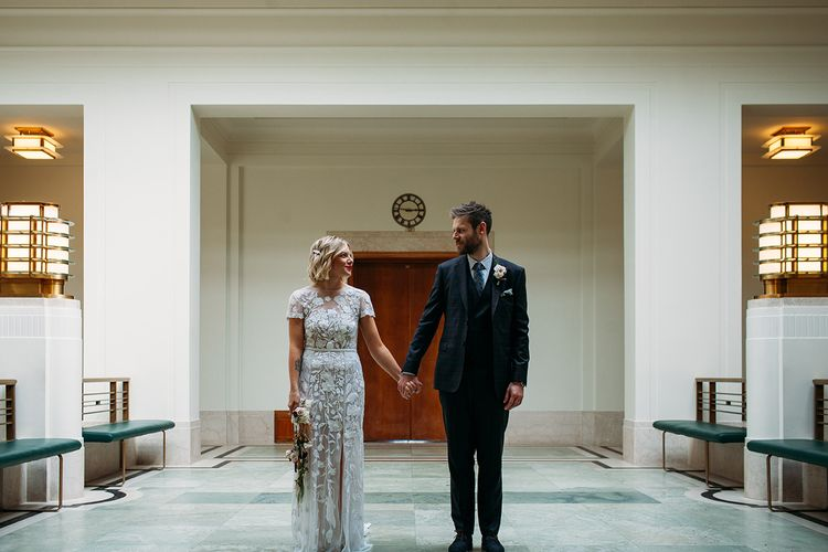 Stylish Bride in Lace Hermione De Paula Wedding Dress and Groom in Ted Baker Suit at Hackney Town Hall