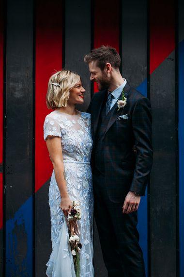 Bride in Lace Hermione De Paula Wedding Dress and Groom in Ted Baker Suit