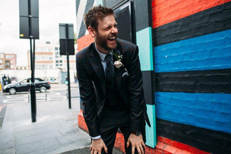Laughing Groom in Ted Baker Wedding Suit