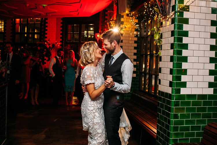 First Dance at Singer Tavern with Bride in Lace Hermione De Paula Wedding Dress and Groom in Check Ted Baker Suit