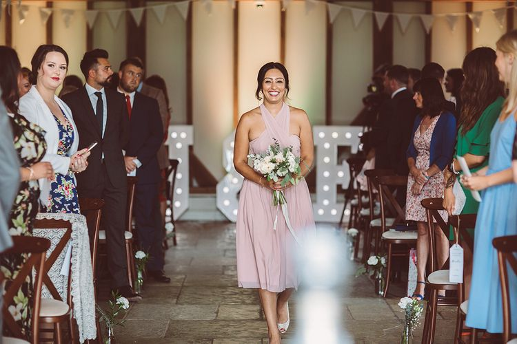 Bridesmaids In Pale Pink Dresses // Brookfield Barn Wedding Venue With Rustic Styling And Bride In Enzoani With Images From Lemonade Pictures And Film By Kitebox Films