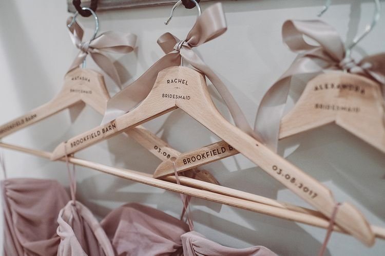 Personalised Hangers For Bridesmaids // Brookfield Barn Wedding Venue With Rustic Styling And Bride In Enzoani With Images From Lemonade Pictures And Film By Kitebox Films