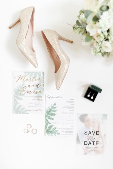Gold glitter wedding shoes and wedding stationery