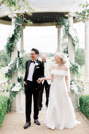 Confetti exit at Froyle Park wedding ceremony