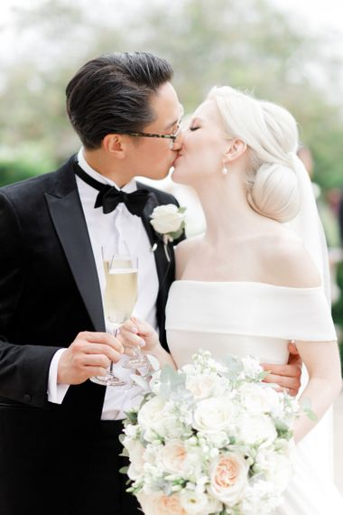 Bride and groom kissing at Froyle Park wedding