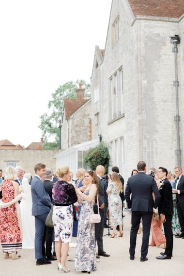 Wedding guests gathered outside Froyle Park