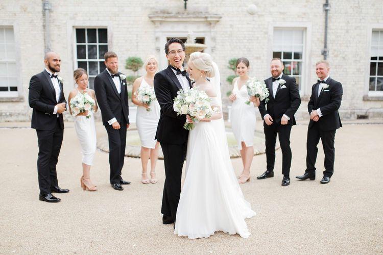 Wedding party in black tie attire at Froyle Park wedding