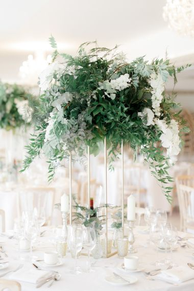Tall white flower and greenery wedding centrepiece