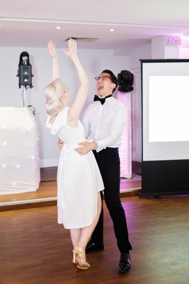 Bride and groom perform dirty dancing routine at Froyle Park wedding