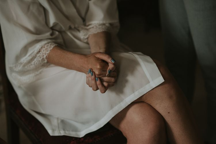Bride in Getting Ready Robe with Blue Nail Polish