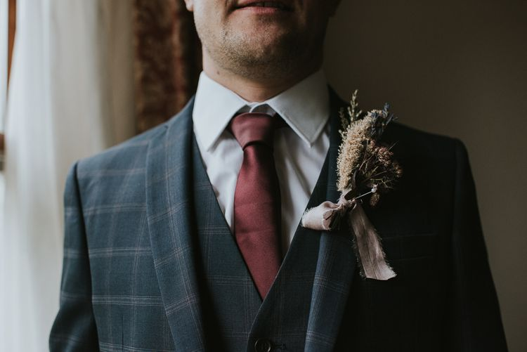 Groom in Check House of Fraser Suit with Burgundy  Tie and Dried Flower Buttonhole