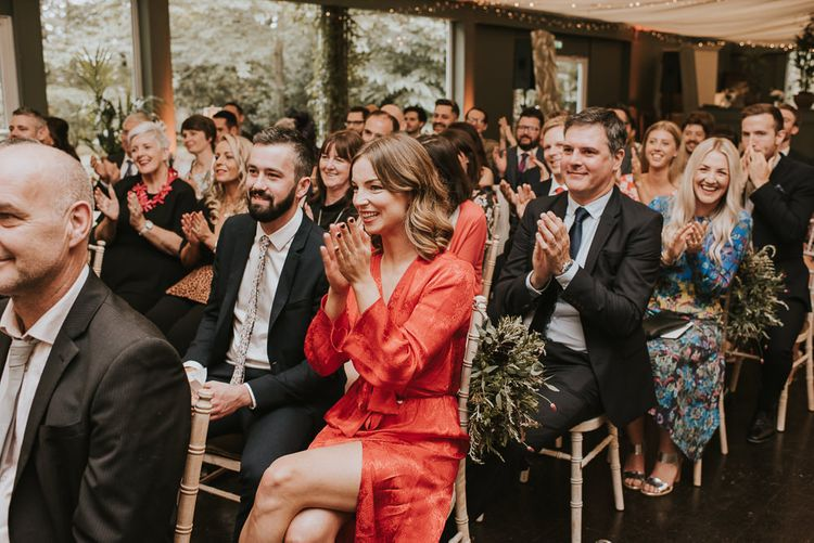 Wedding Guests Clapping During The Wedding Ceremony