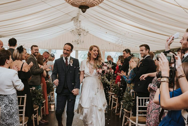 Bride in Houghton NYC Wedding Dress and Groom Check Suit Just Married Showered in Confetti