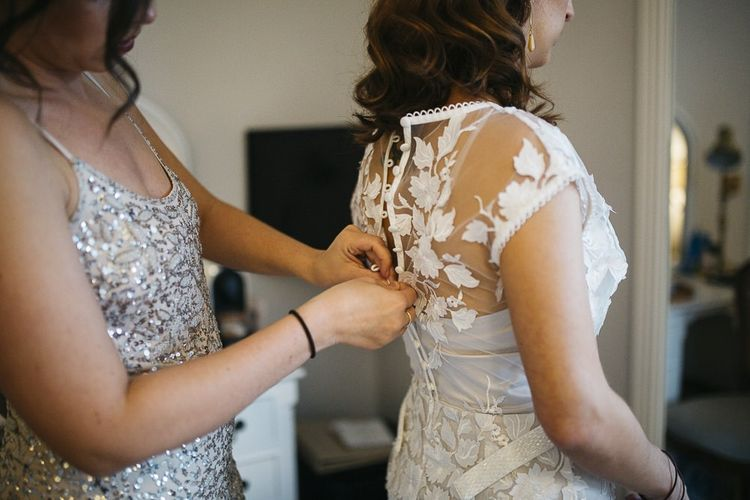Bride wearing Phase Eight Wedding Dress with her bridesmaid in embellished dress