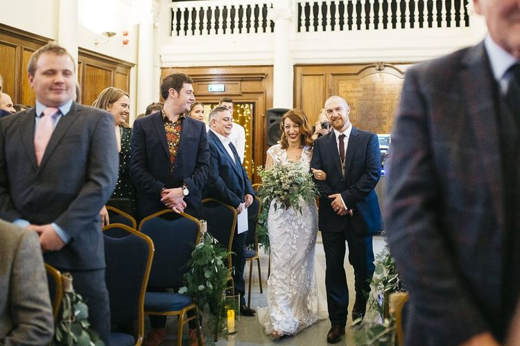 Bride wearing Phase Eight Wedding Dress walking down the aisle at London ceremony
