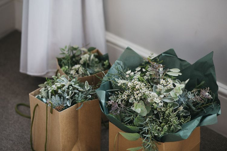 Green and white foliage for wedding flowers at London wedding