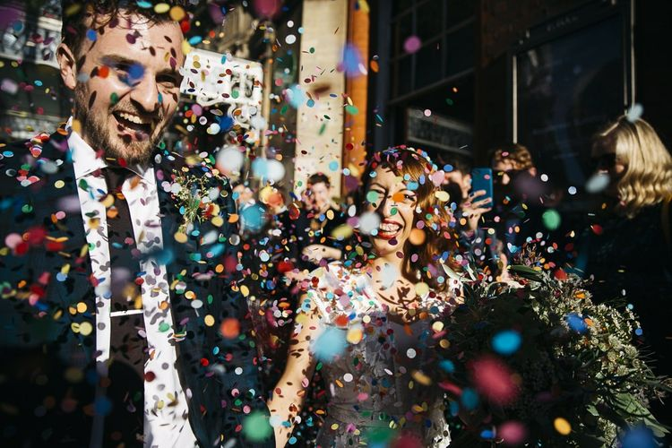 Bride and groom confetti shot at autumn celebration in London