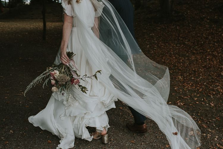 Bride in Tiered Houghton NYC Wedding Dress and Wedding Veil
