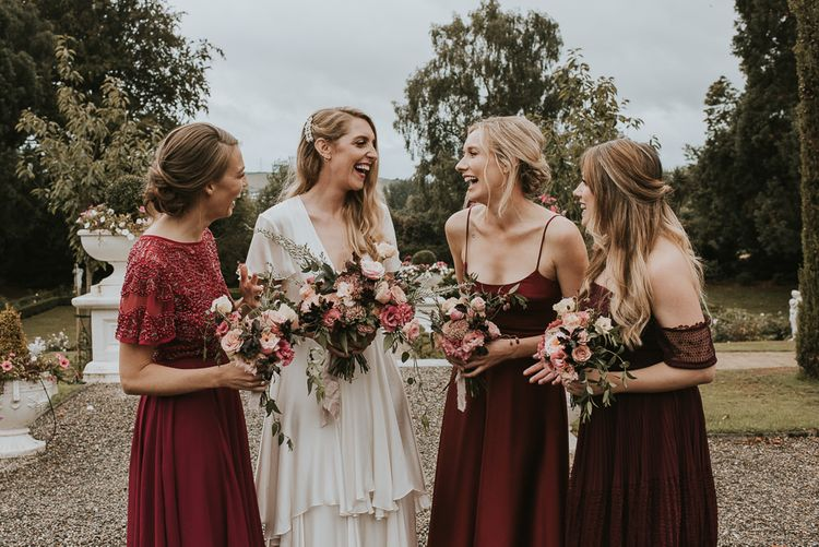 Bride in Tiered Houghton NYC Wedding Dress and Bridesmaids in Burgundy ASOS Dresses
