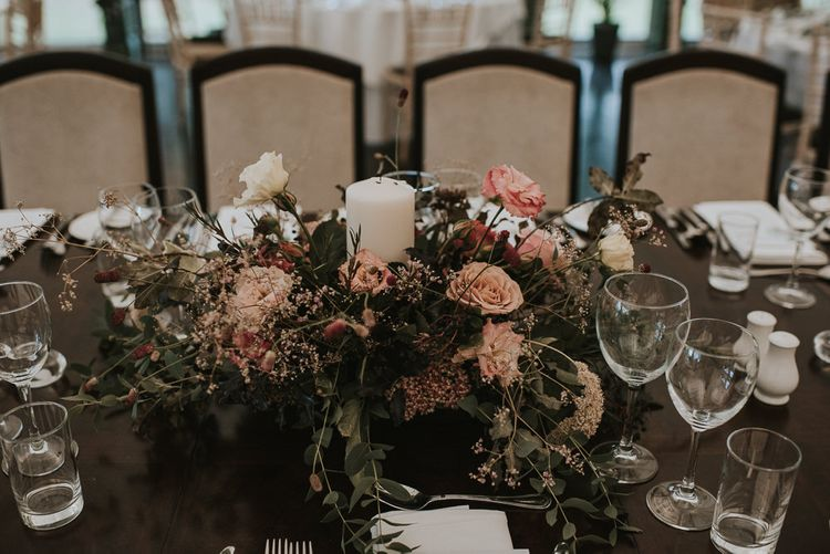 Floral Centrepiece with Church Candle and Pink Flowers