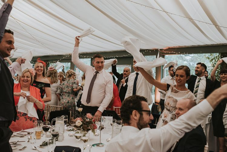 Wedding Guests Waving Their Napkins During the Wedding Reception