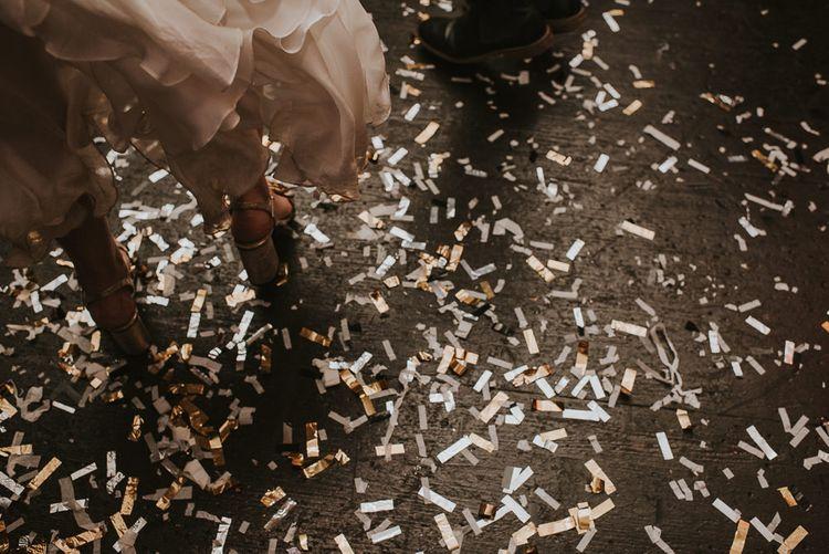 Gold Confetti Bomb Sprinkles on The Dance Floor