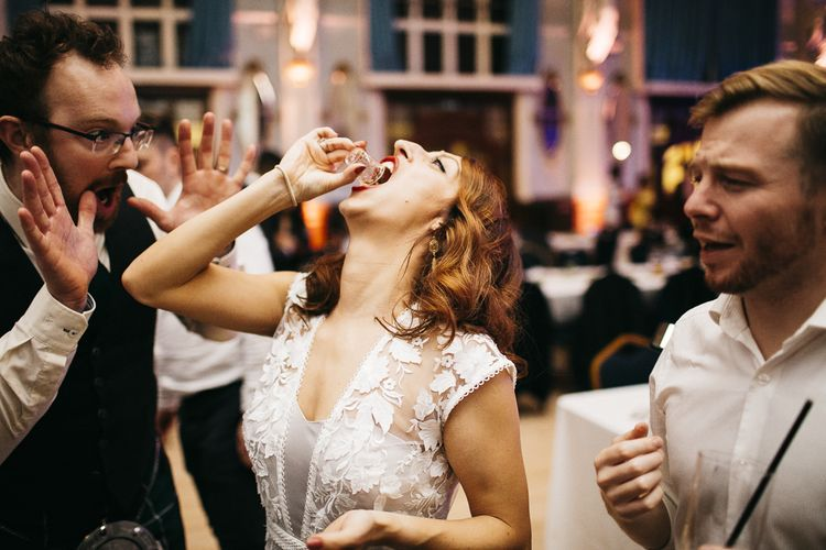 Bride having a vodka jelly shot with guests at London celebration