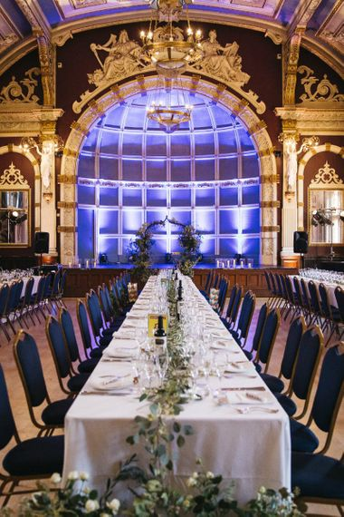 London reception with vintage decor and foliage styling