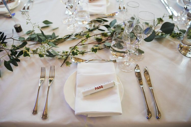 Table styling with personalised Love Heart place settings and foliage decor