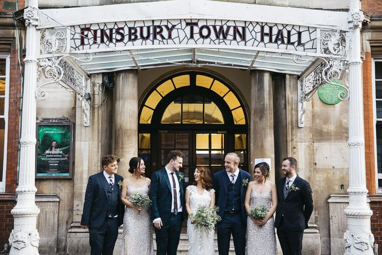 Bride wearing Phase Eight Wedding Dress with her  Groom and guests at Finsbury Town Hall reception